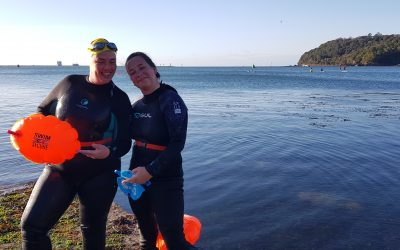 Swimmer assisted ashore by project partner members